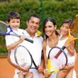 Family playing tennis — Stock Photo #8832266