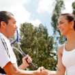 Tennis couple handshaking - Stock Photo
