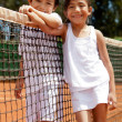 Sibblings at a tennis court — Stock Photo #8832312