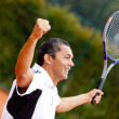 Man winning at tennis — Stock Photo #8832370