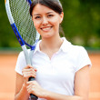 Woman playing tennis — Stock Photo #8832382