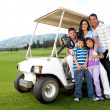 Stock Photo: Family with a golf cart