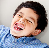 Kid making faces — Stock Photo