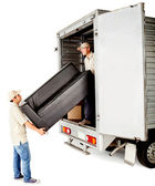 Delivery men with a sofa — Stock Photo
