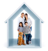 Family in a 3D house — Stock Photo