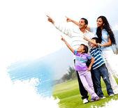 Familia apuntando al aire libre — Foto de Stock