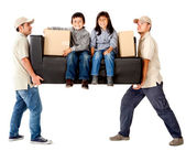 Delivery men carrying a couch — Stock Photo