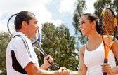 Tennis couple handshaking — Stock Photo