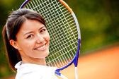Beautiful woman at tennis — Stock Photo