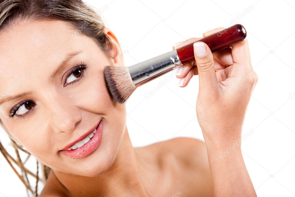Woman applying rouge with a make up brush - isolated over a white background — Stock Photo #8831924