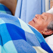 Elder woman at the hospital — Stock Photo