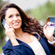 Shopping woman on the phone — Stock Photo #8849358