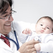 Royalty-Free Stock Photo: Doctor holding a baby