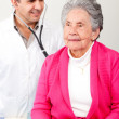 Stock Photo: Old womhaving check up
