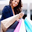 Shopping woman on the phone — Stock Photo #8849587