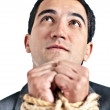 Tortured business man - Stock Photo