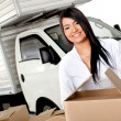 Stock Photo: Wommoving house