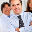 Business man with a group — Stockfoto