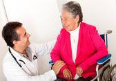 Elder woman in wheelchair — Stock Photo