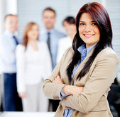Business woman with a team — Stock Photo