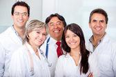 Patiënt met een groep van artsen — Stockfoto