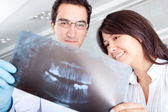 Dentist looking at an x-ray — Stock Photo