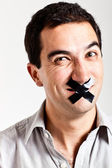 Man struggling to keep quiet — Stock Photo