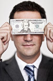 Blinded by the money — Stock Photo