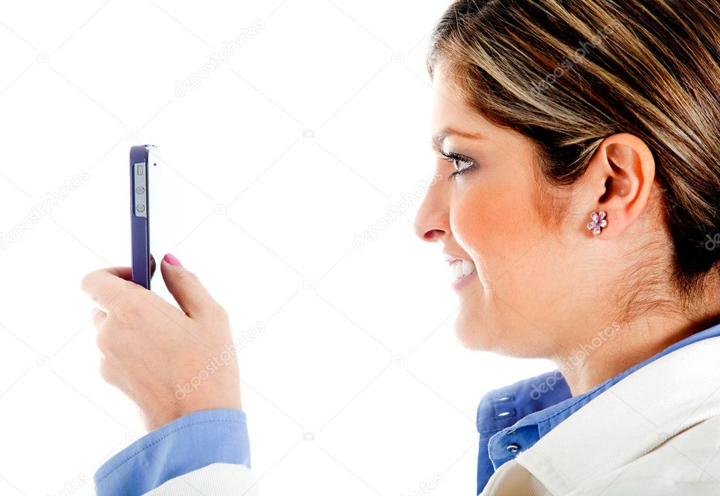 Woman texting on her cell phone - isolated over a white background — Stock Photo #8849856