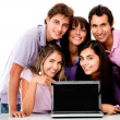 Casual group with laptop — Stock Photo #8850097