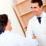 Pharmacist and business man handshaking — Stock Photo #8850130