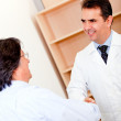 Stock Photo: Pharmacist and business mhandshaking