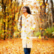 Autumn woman walking outdoors — ストック写真