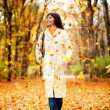 Autumn woman walking outdoors — Stock Photo #8850323