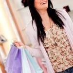 Happy female shopper — Stock Photo