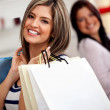 Women with shopping bags — Stock Photo #8850445