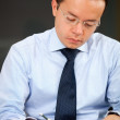 Male teacher grading exams - Stock Photo