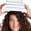 Female student balancing books — Stock Photo