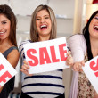 Saleswomen on sale — Stock Photo