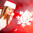 Female Santa with a snowflake — Stock Photo #8850685