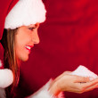 Female Santa holding snow — Stock Photo #8850691