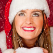 Stock Photo: Female Santa under falling snow