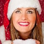 Female Santa under falling snow — Stock Photo