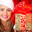 Mrs. Claus with a present — Stock Photo #8850698