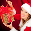 Female Santa with gifts — Stock Photo