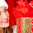 Female Santa with a gift — Stock Photo