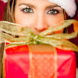 Mrs. Claus with a present — Stock Photo #8850706