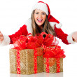 Female Santa with gifts - Stock Photo