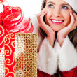 Thoughtful female Santa with presents — Stock Photo