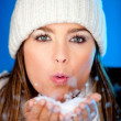 Woman blowing snow — Stock Photo #8850735